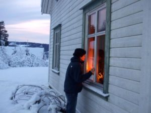 Gerry peering inside a Norwegian house exhibit