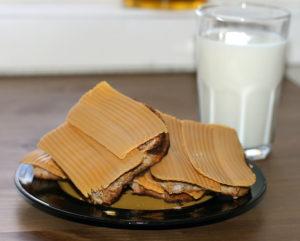 Norwegian brown cheese with milk