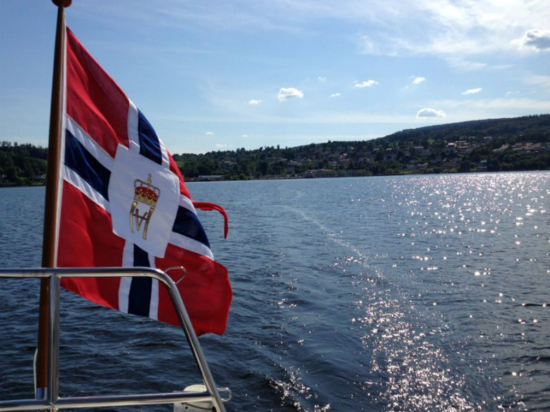 Norwegian flag over the water