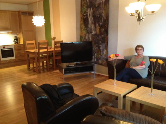 Mum enjoying herself in the lounge!