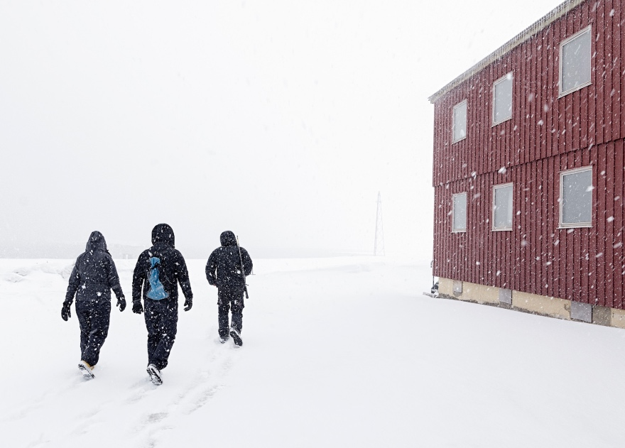 Walking through Ny-Ålesund in Svalbard