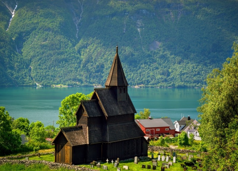Stave churches by a Norwegian fjord