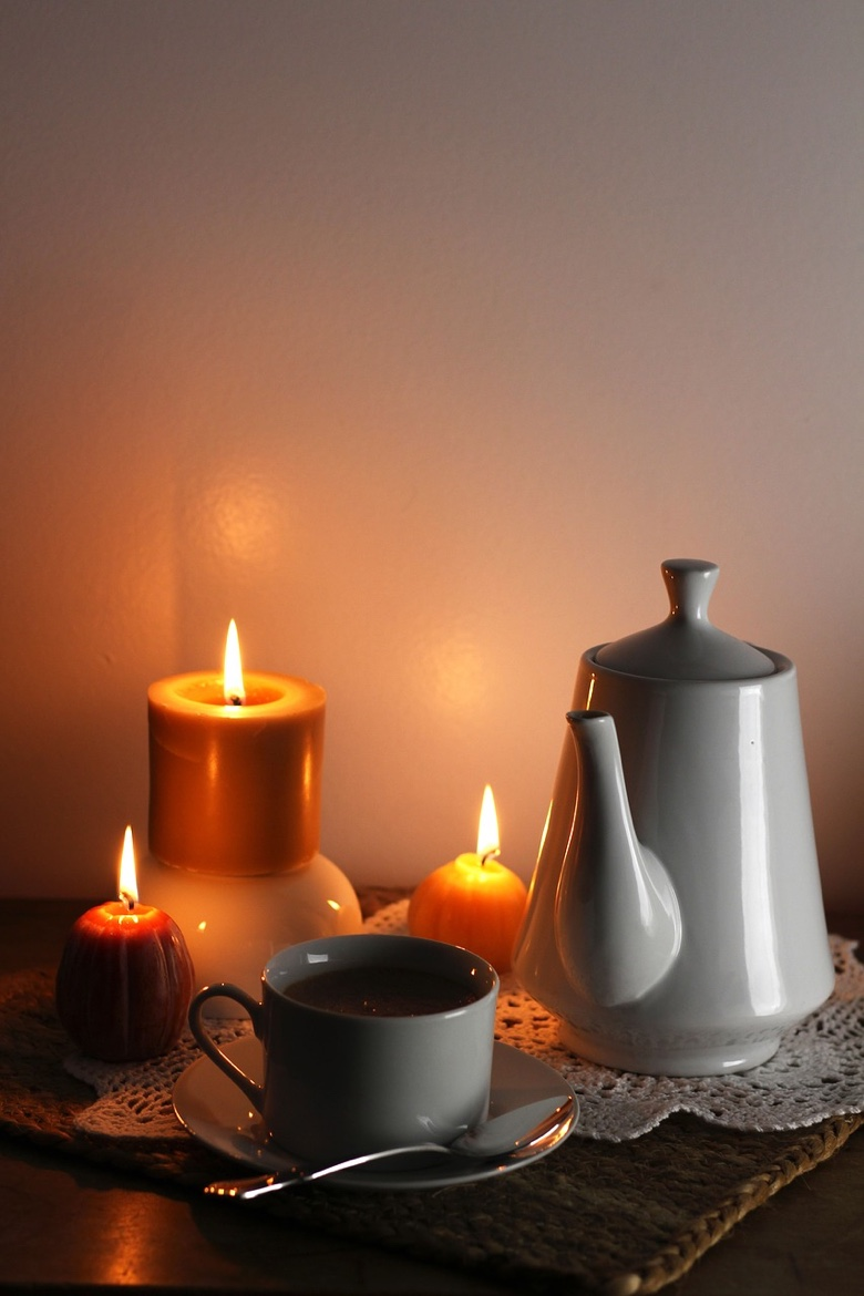 Hygge design: Candles help create a cozy minimalism in a Scandinavian home or cabin.