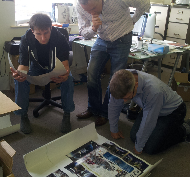 Curis, Mark and Ronnie cast a careful eye over the Deadzone box cover before it goes to print...