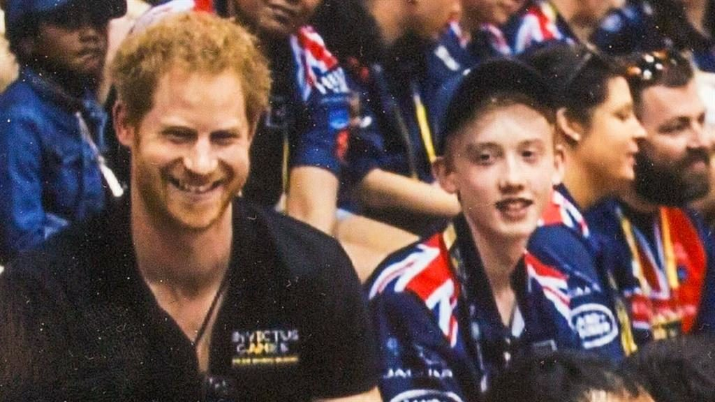 Happy for once: Sam Abel meets Prince Harry during the Invictus games last year