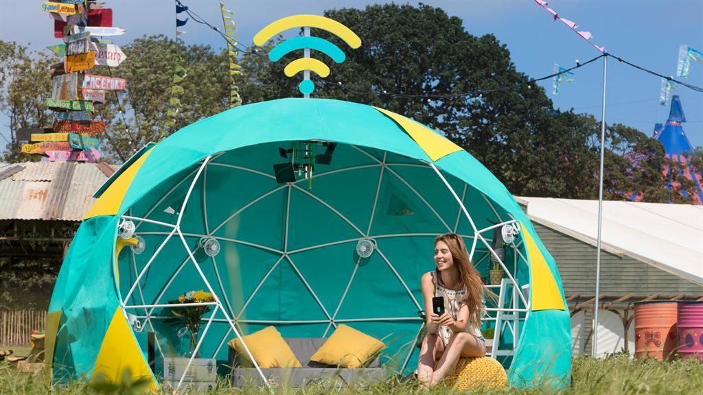 All mod cons: The tent has live streams and a smart fridge (pictured below) and wellie dryer PICTURE: EE