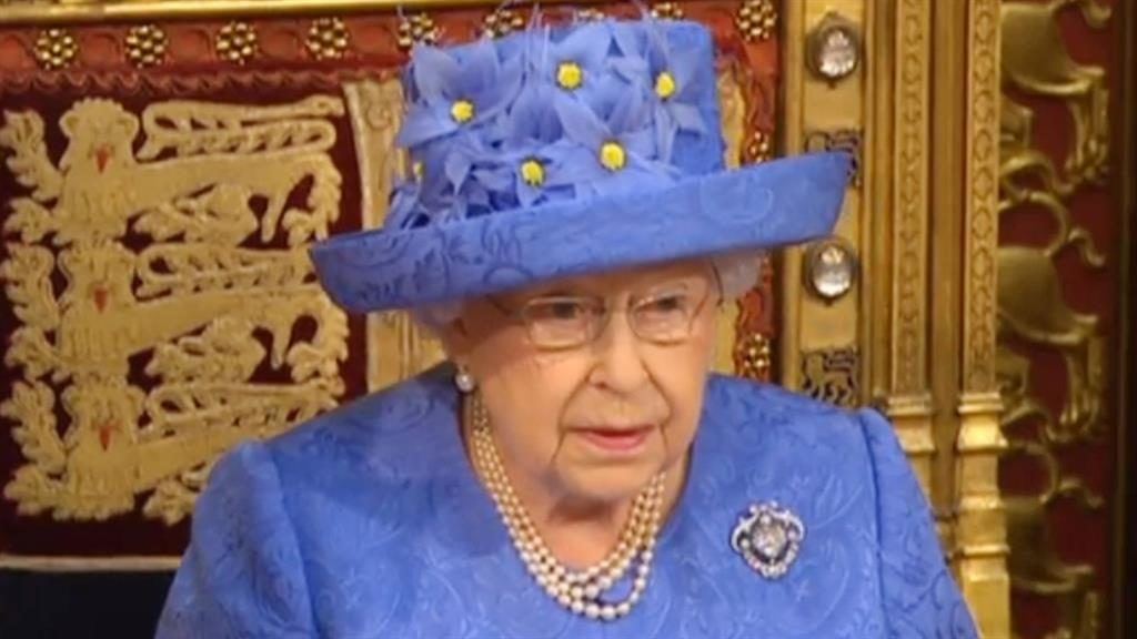 Queen tells agenda, scaled down by May
