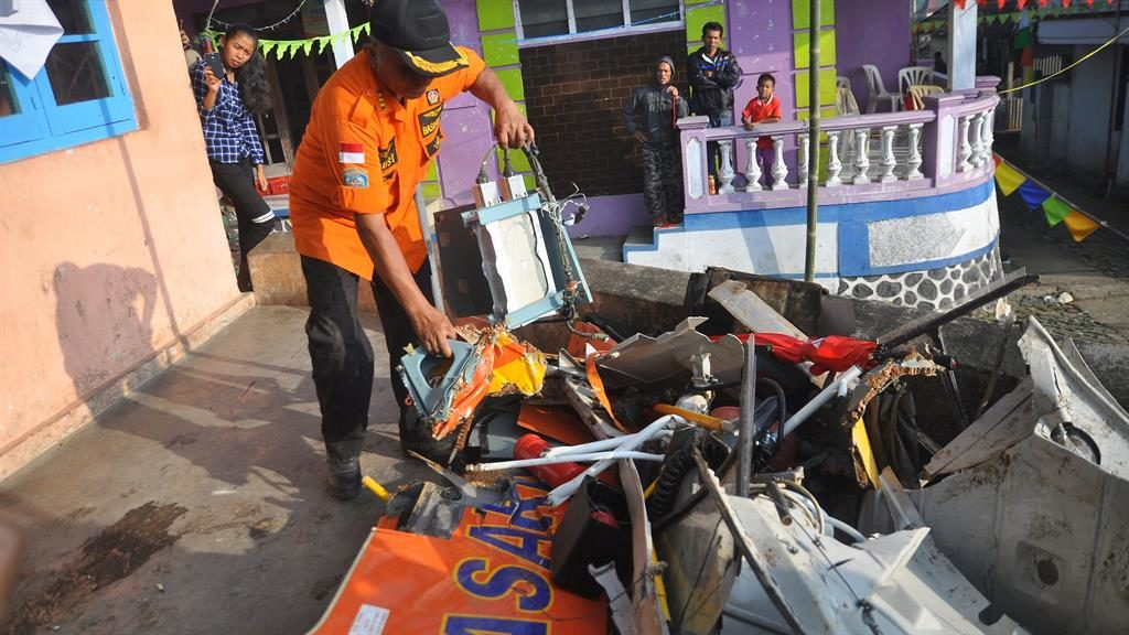Indonesian aid helicopter crash kills 8 rescuers
