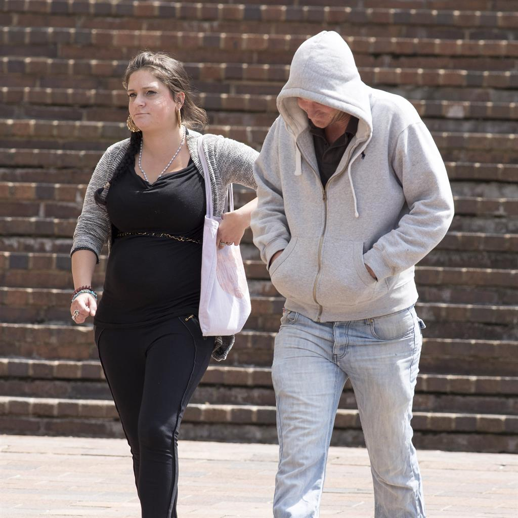 'Catastrophic' injury: Katherine Cox and Danny Shepherd leave court yesterday. They deny causing Eli's death PICTURE: JIM BENNETT