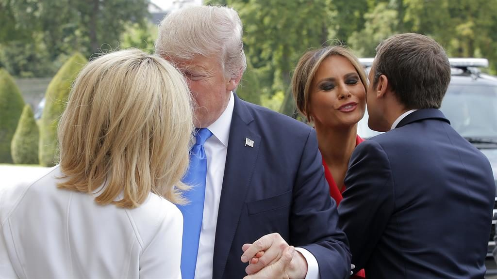 French kisses Mr Trump and Mr Macron greet each other's wives