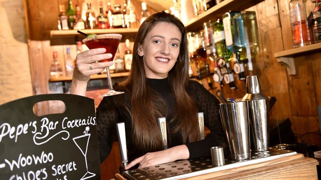 Mixing it: Chloe Hogg with a cocktail behind the bar at Fantails in Cumbria PICTURE: CASCADE