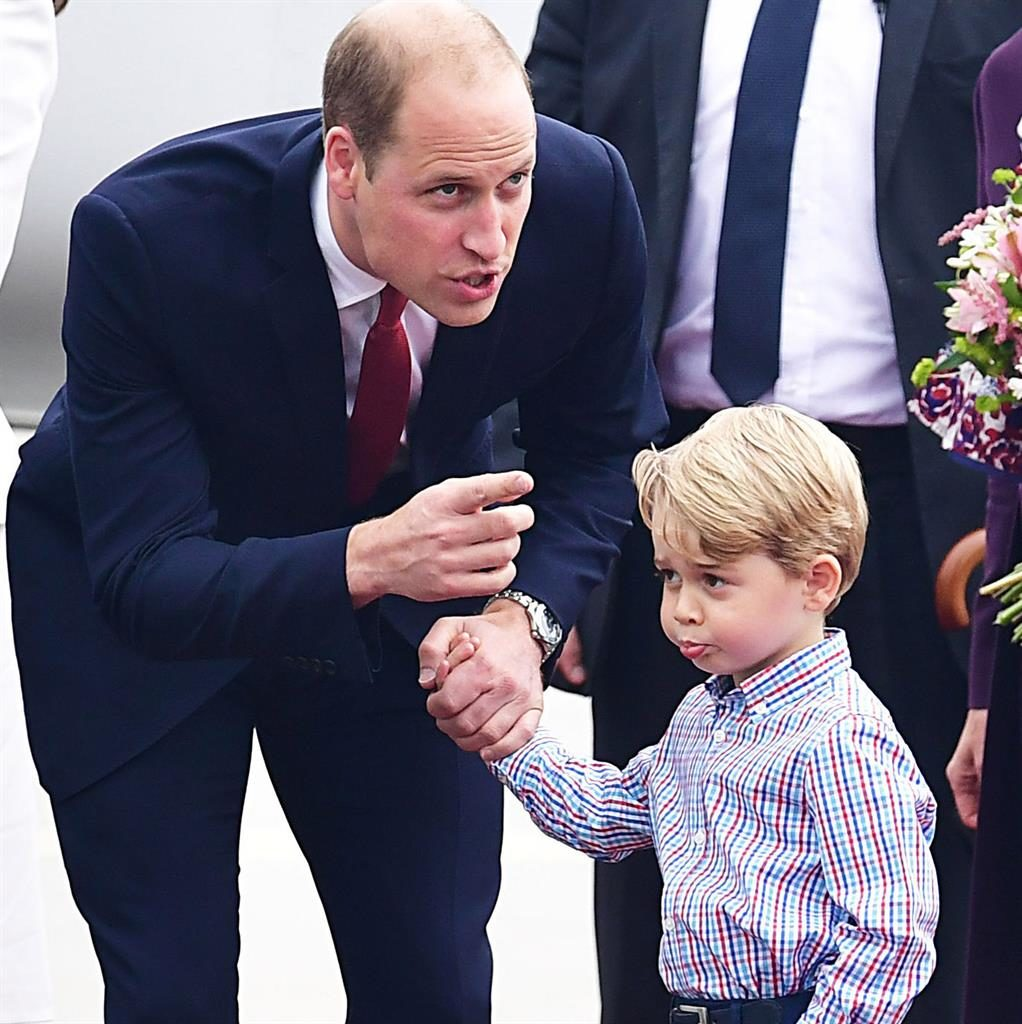 Pouts are out William offers words of encouragement but George looks as if he'd rather be back on the plane with sister Charlotte