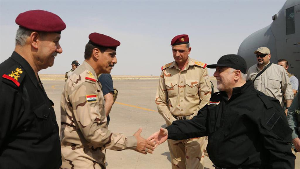 Job done Iraqi PM Haider al Abadi shakes hands with his officers in Mosul