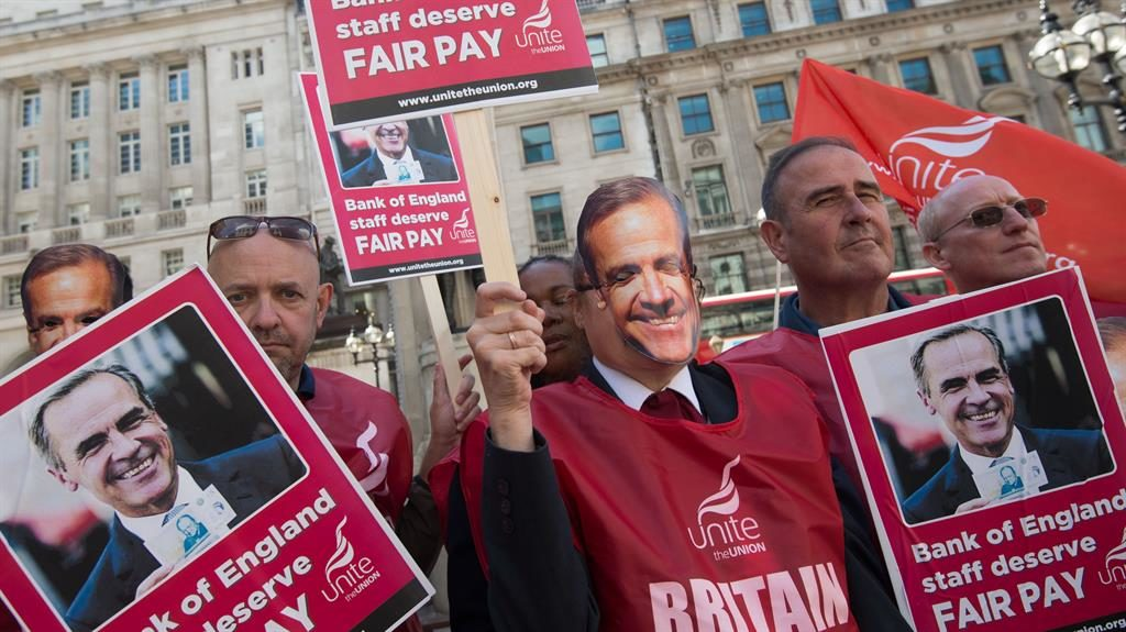 On their marks Unite members and workers in Carney masks picket the Bank's head office in the City of London