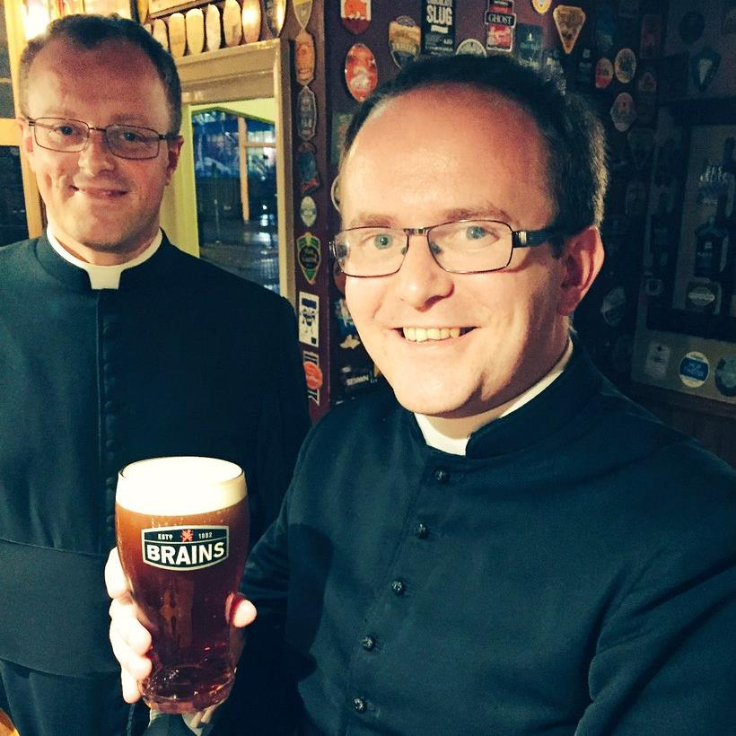 Name sake: Rev James (right) has a Rev James beer with Rev Williams