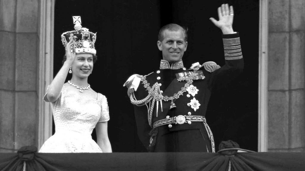 Early days: The Queen and Prince Philip wave to supporters from the balcony at Buckingham Palace following her coronation in 1953