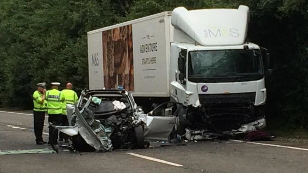 Wreckage: Police stand next to the family's Kia Sportage and M&S lorry in Barnstaple, north Devon PICTURE: IRVING/EXETER