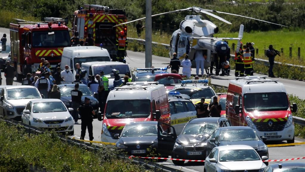 Ambush: Police vehicles surround Bachir's BMW with a smashed windscreen yesterday PICTURE: REUTERS