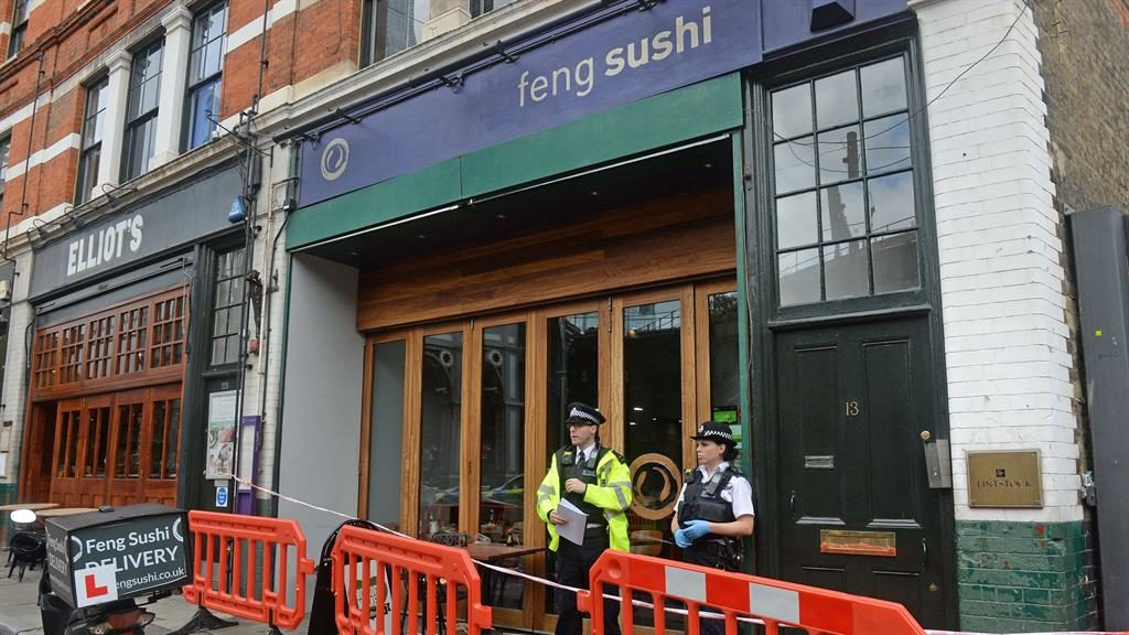 Sealed off: Police stand guard outside the Feng Sushi restaurant PICTURE: PA