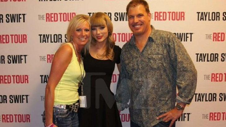 The fateful photo: DJ David Mueller and his girlfriend Shannon Melcher get their picture taken with Taylor Swift before a 2013 concert PICTURE: TMZ