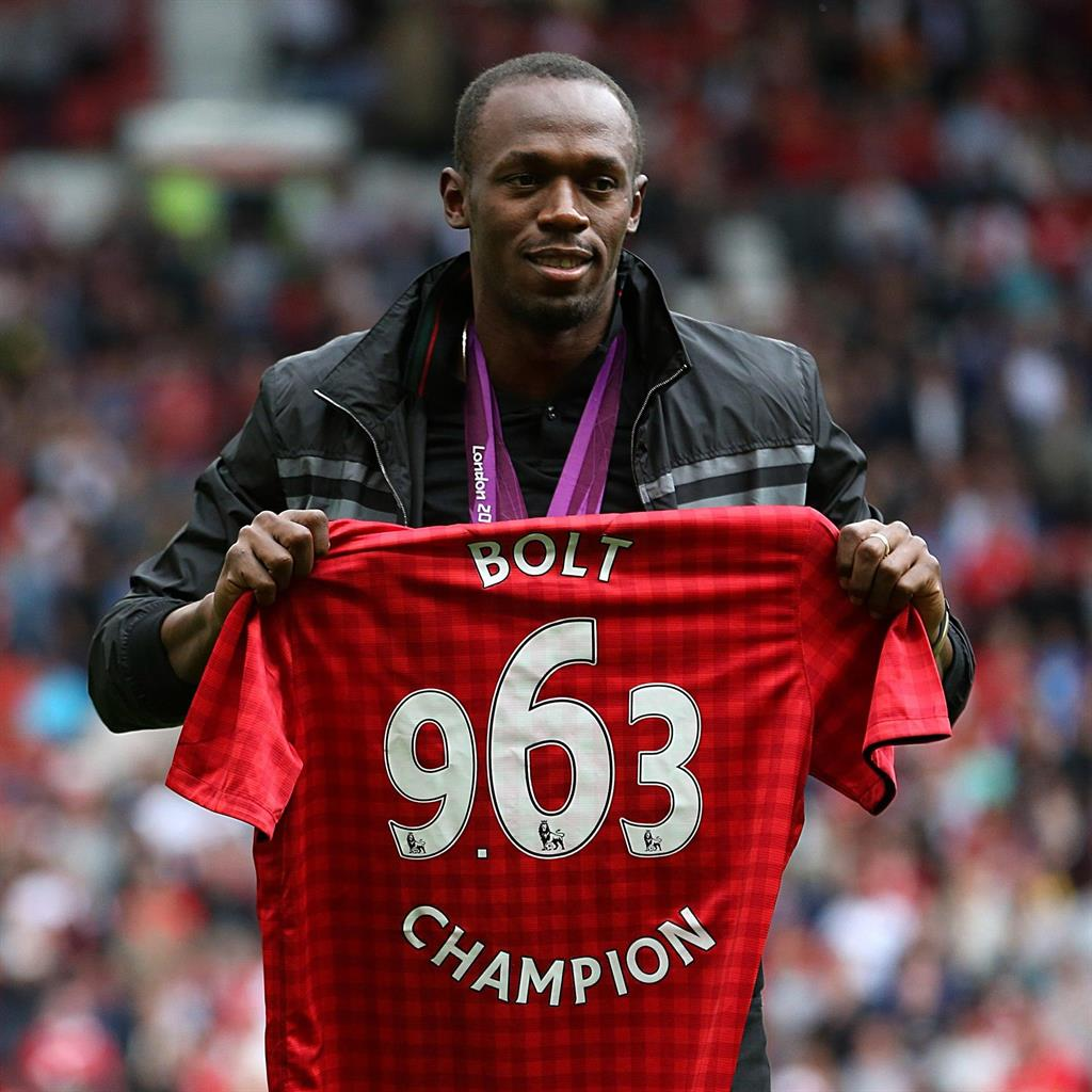Footie fan: Bolt has his own shirt PIC: PA