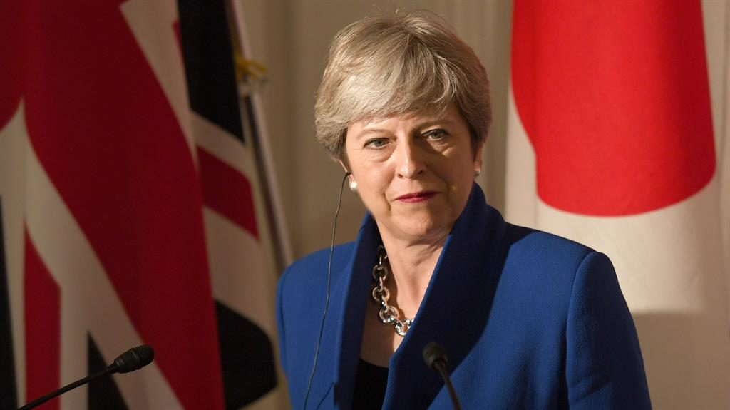 Getting on with the job: May during a press conference in Japan PICTURE: PA
