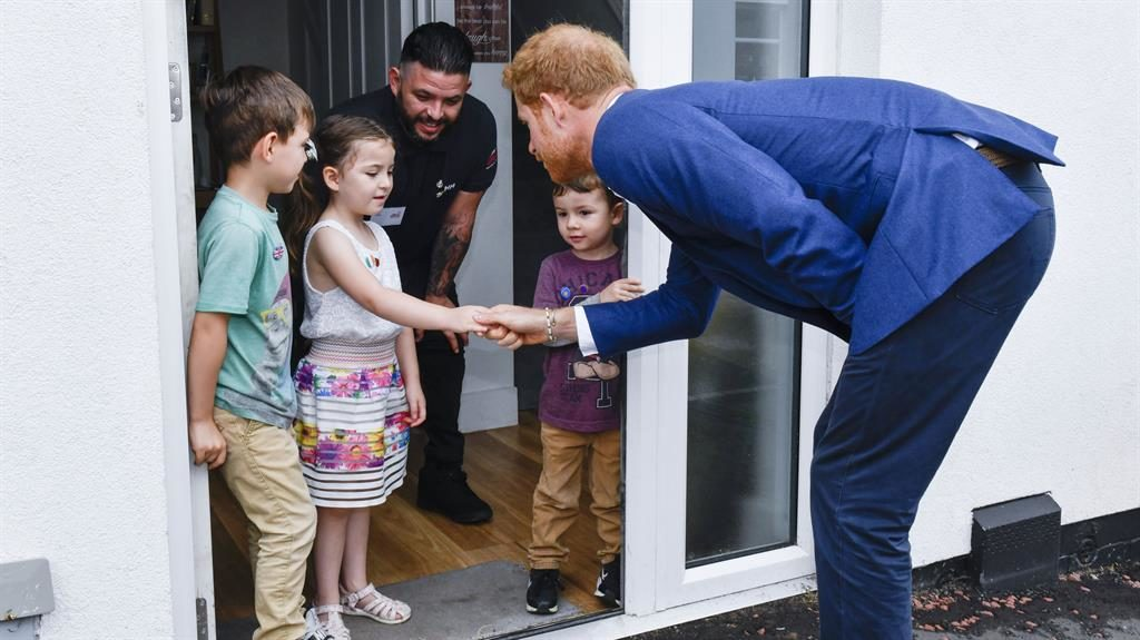 Prince Harry revisits veterans' DIY SOS homes scheme