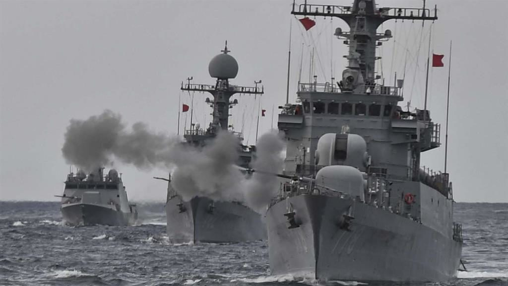 Warning shots: A South Korean navy ship fires during a drill in South Korea's East Sea PICTURE: AP