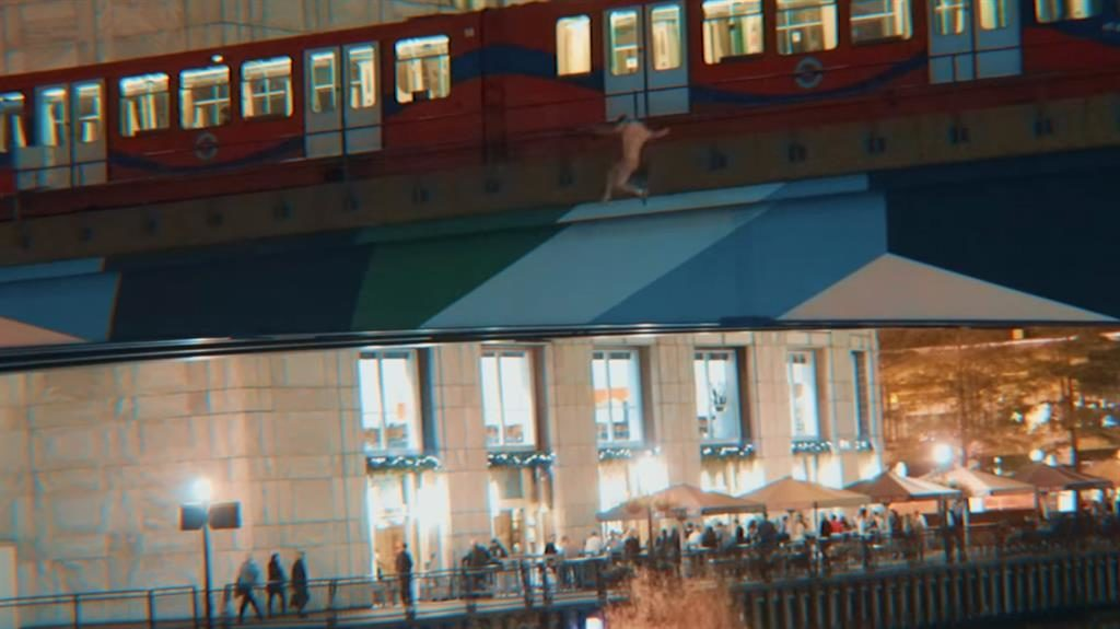 Risky: A man leaps into the water from the train in front of Docklands diners in a stunt condemned by police PICTURE: RIKKE BREWER/YOUTUBE