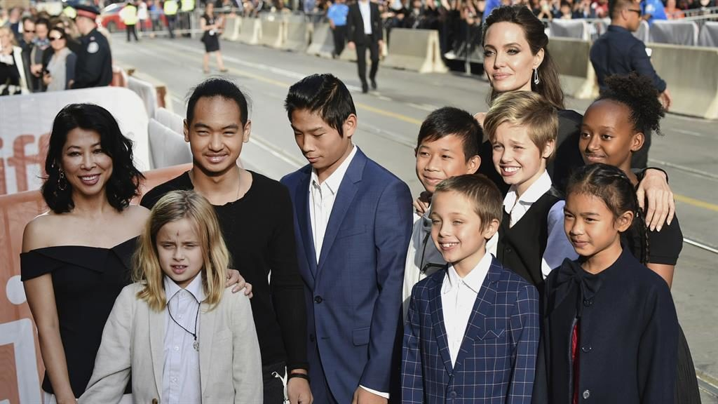 One big family Front row from left- Vivienne Jolie-Pitt Knox Jolie-Pitt Sareum Srey Moch middle row from left- Loung Ung Maddox Jolie-Pitt Pax Jolie-Pitt Kimhak Mun Shiloh Jolie-Pitt Zahara Jolie Pitt and Angelina Jolie