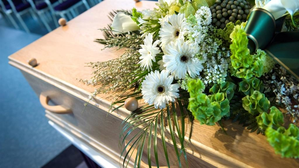 Pricey: Coffin and flowers PICTURE: ALAMY