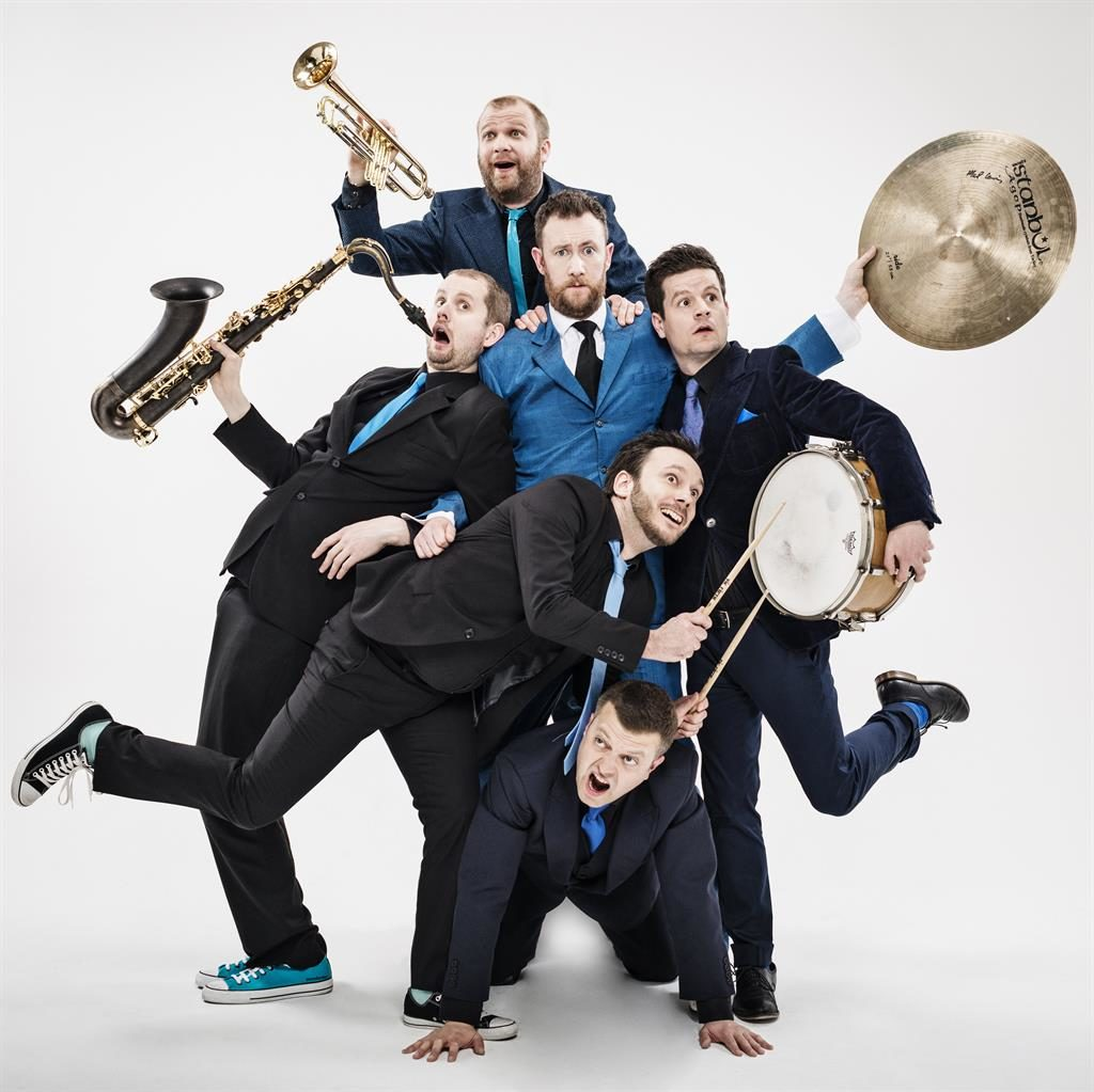 Man of note: Comic Alex (centre) with the Horne section