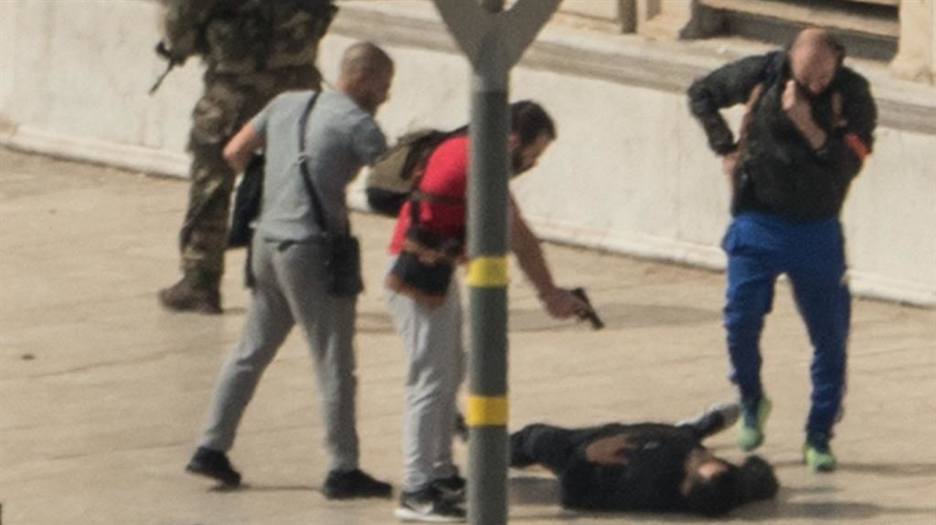 Gunpoint: French security forces tackle a suspect outside Marseille station PICTURE: AFP