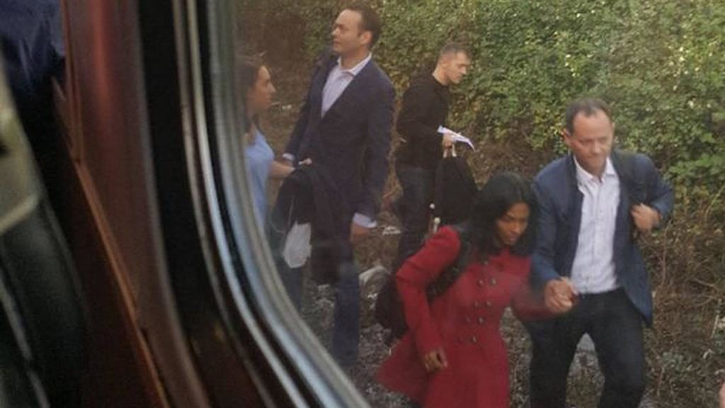 Commuters jump on train tracks to escape 'preacher'