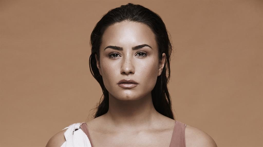 Demi Lovato couldn't listen to her own music while making love