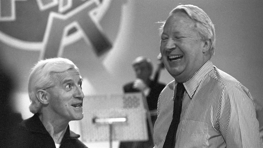 Laughter: Rehearsing with disgraced DJ Jimmy Savile for an episode of Jim'll Fix It in 1980 PICTURES: PA