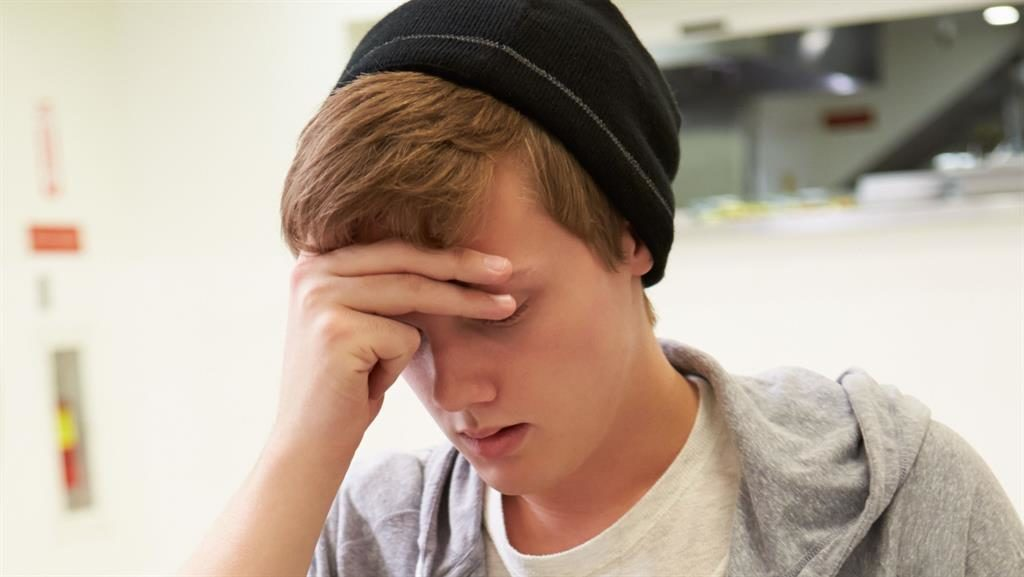 Up against it: Under 25s are struggling with debt, according to the report