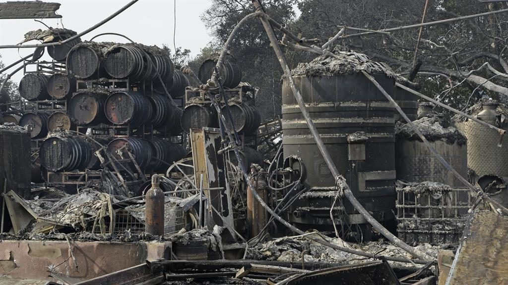 Scene of destruction: Charred remains of wine-making vats and barrels in Santa Rosa, California PIC: AP