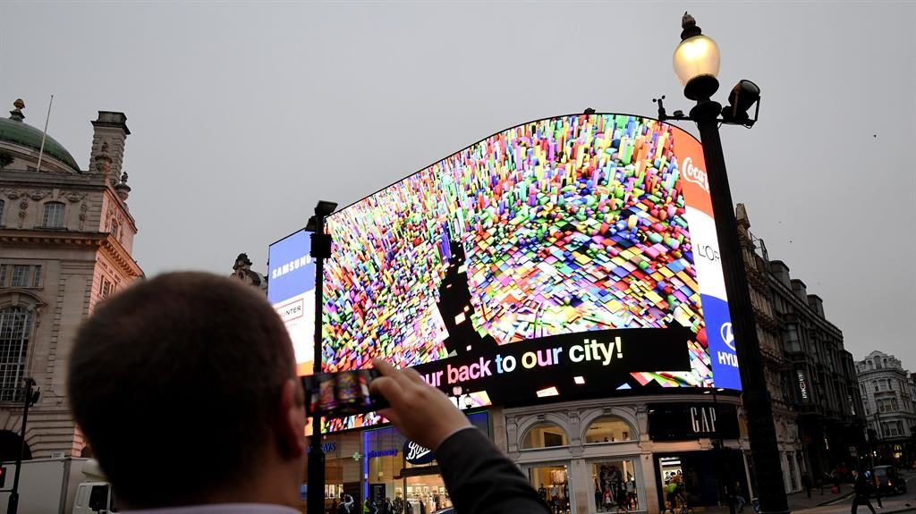 Dazzling: The state-of-the-art new screen was switched on after a ninemonth revamp of the old billboards PICTURES: PA