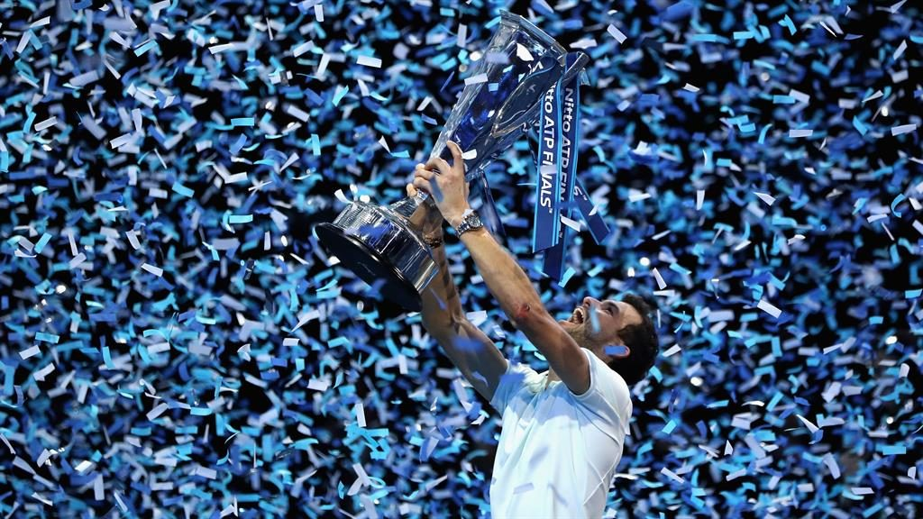 Special moment Dimitrov holds aloft the ATP Finals trophy