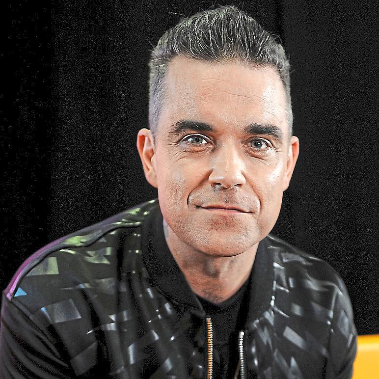 Under par: Robbie Williams' second compilation of extras will appeal to his dedicated following