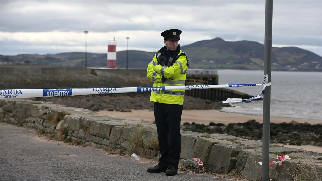 Secene A policeman at Buncrana Pier after the tragedy