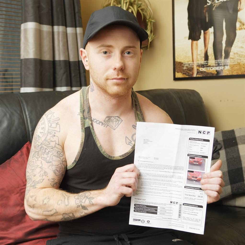 'Outrageous': Patrick Barry holds the £50 penalty that states he was two minutes over the limit PICTURE: SOLENT