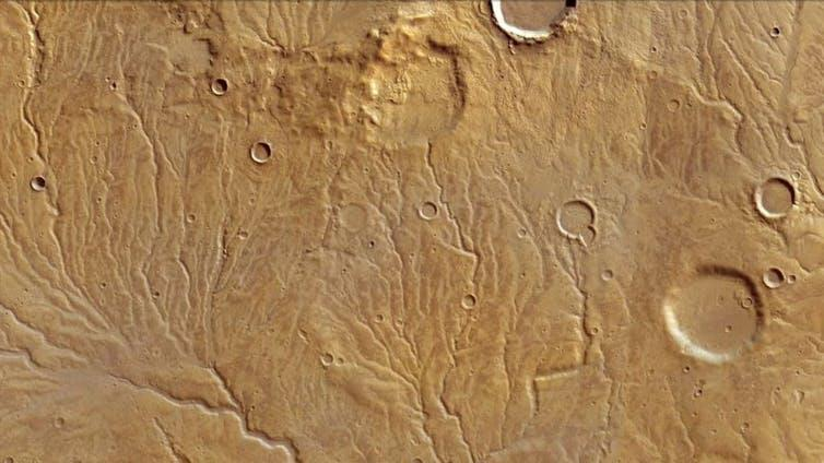 Branching tributaries with ancient valleys seen in a 120km wide region of Mars. GoogleEarth (ESA/DLR/FU Berlin)