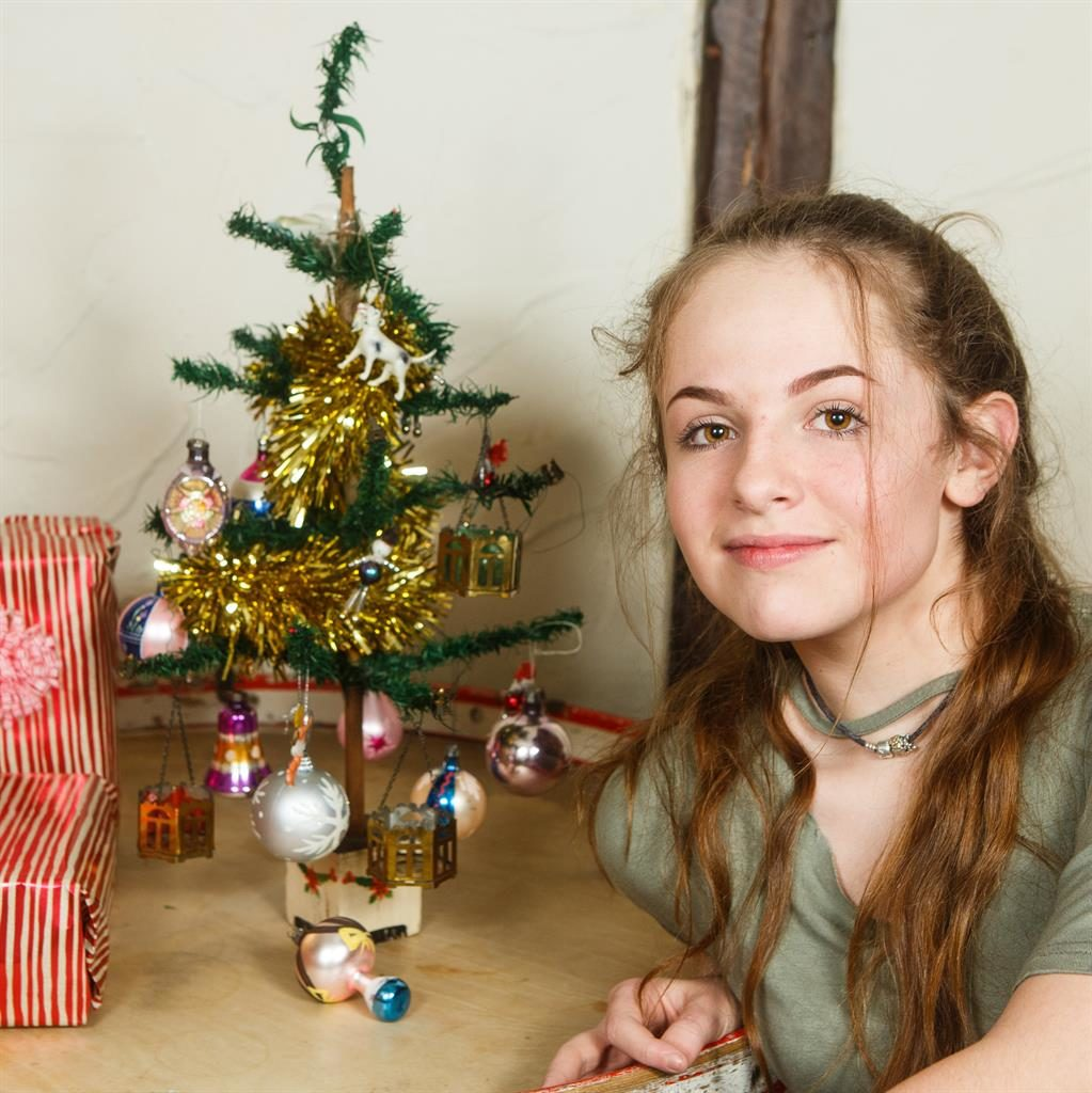 Built to last: Kay's granddaughter Phoebe, 13, with the tree PICS: SWNS