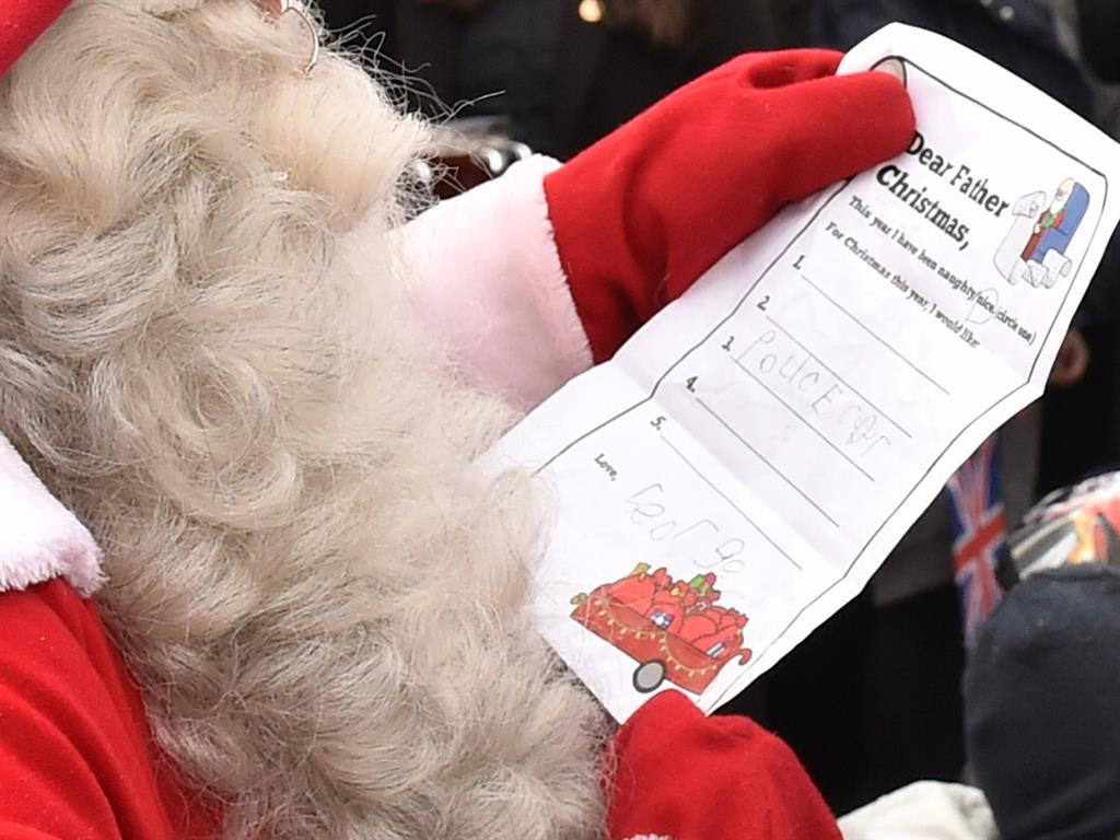 Asking nicely Santa reads the request written by young George PICS GETTY  PA
