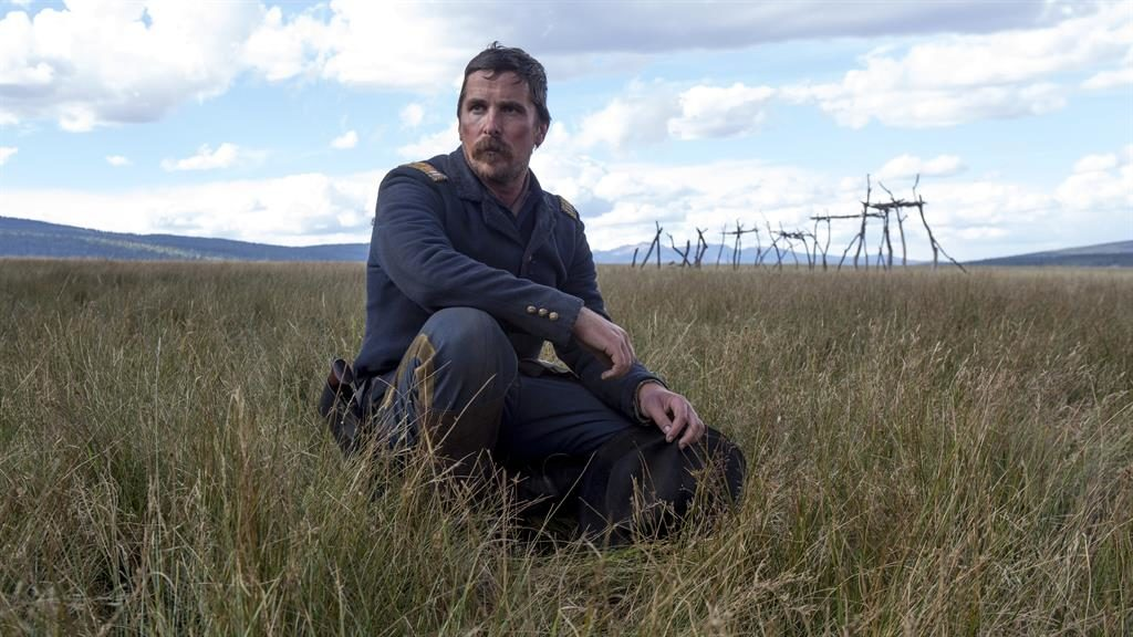 Christian Bale laughs at romantic comedy offer