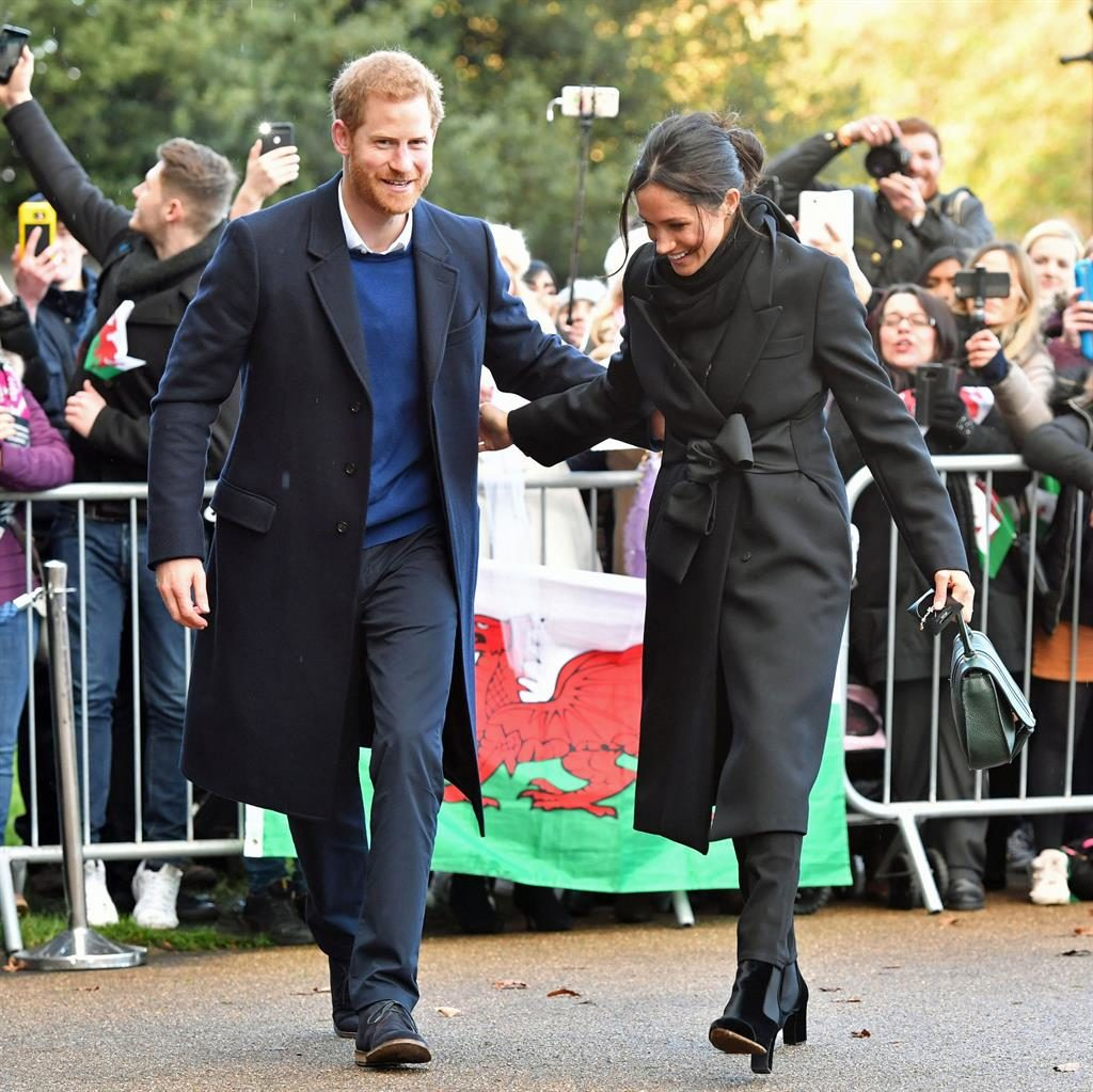 Flying the flag: Prince Harry and Meghan Markle at Cardiff Castle yesterday PICTURES: PA/WALES NEWS/REX