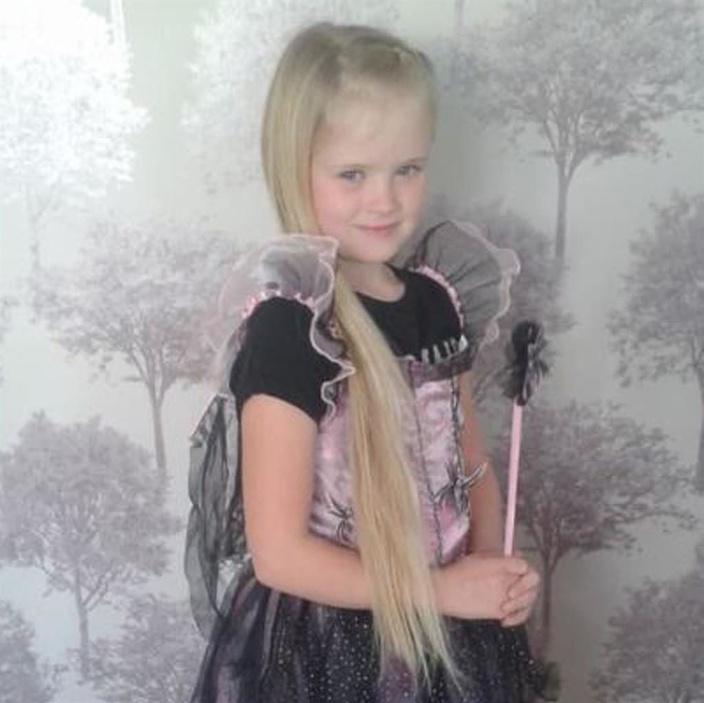 Man arrested after schoolgirl, eight, is stabbed to death in 'domestic incident'