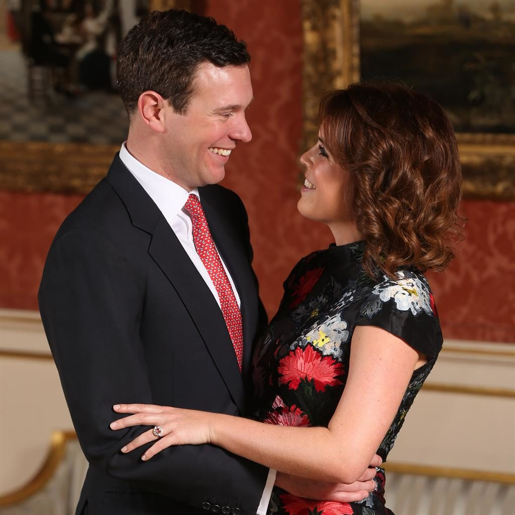 Smiles: Jack and Eugenie yesterday as she reveals her padparadscha sapphire and diamond ring PIC: PA